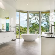 ​​​​​​​Celebrating the scenery – this master ensuite, part gray, white