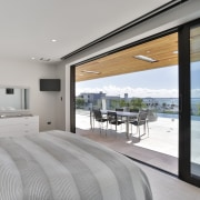 ​​​​​​​This master bedroom in a harbourview home is gray