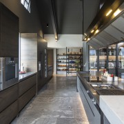 In this kitchen, by Masterwood, a bank of black, gray