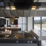 The commercial extractor over the chef's island is black, gray