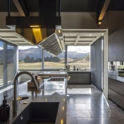 For this industrial-look kitchen by Stefan Sonntag of gray, black