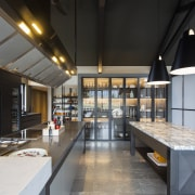 Varied overheads – in this industrial chic kitchen, black, gray