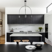 ​​​​​​​A modern kitchen in a modest-sized home, this white