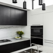 ​​​​​​​This kitchen's minimalist lines connect with the wider white