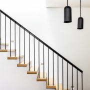 ​​​​​​​Wood topped and steel based, this cantilevered staircase white