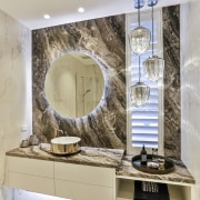 In this powder room, by Dunlop Design, the gray