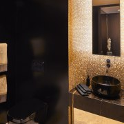 Where's the toilet? Black recedes and gold mosaic black