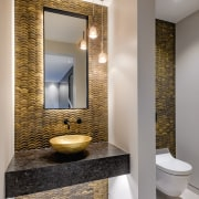 ​​​​​​​For this powder room by designer Davinia Sutton, gray