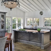 The island in this traditional includes classic detailing gray