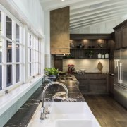 ​​​​​​​This kitchen by designer Shane George of Kitchens gray, white