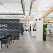 Much of the ambient lighting in Attraction Media's architecture, building, ceiling, commercial building, design, floor, flooring, furniture, interior design, lighting, loft, office, room, tile, wall, white, gray