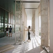 A student manipulates the moveable and replaceable aluminium architecture, building, ceiling, column, daylighting, gray