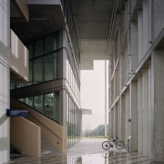 The ground-floor entry to the SDE4 building is architecture, building, facade, glass, material property, SDE4 building, raw materials, natural steel, metal, concrete, SDE4 building