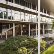 The innovative SDE4 building is much like a apartment, architecture, building, campus, condominium, courtyard, facade, home, house, mixed-use, property, real estate, residential area, room, tree, window, brown