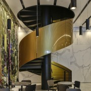 A sculptural gold spiral staircase in the lobby architecture, building, ceiling, design, furniture, interior design, lobby, spiral staircase. No 1 Sylvia Park