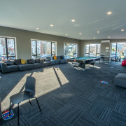 The John McGlashan College rumpus room, built by architecture, building, estate, floor, flooring, furniture, home, house, interior design, living room, lobby, property, real estate, room, table, gray, black