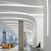 Renovated lobby and greatly improved circulation path gives arch, architecture, building, ceiling, column, daylighting, interior design, line, lobby, gray, white