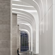Curved Krion panels that flow from the wall arch, architecture, building, ceiling, daylighting, line, lobby, material property, gray