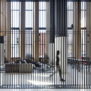 Slender suspended rods provide a transparent divider within architecture, building, Hotel Monville, Montreal Canada, divider, multi-use hotel lobby, suspended rods