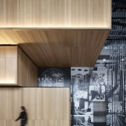 The Hotel Monville lobby features a massive black-and-white architecture, building, design, facade, line, material property, plywood, wall, wood, orange