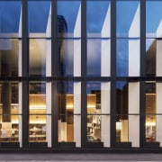The Hotel Monville's three-storey curtain wall podium gives architecture, building, daylighting, facade, glass, metal, reflection, sky, window, black, gray
