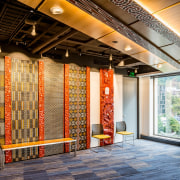 Traditional Māori carvings and advanced AV systems coexist architecture, brick, building, ceiling, door, floor, flooring, interior design, lobby, orange, room, tile, wall