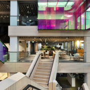 A scissor stair reaches across the atrium divide Mercury, Warren and Mahoney,  architecture, commercial building, design, facade, lobby, mixed-use