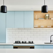 Subway brick tile in white complements pale blue white, gray