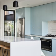 Caesarstone benchtops meet Laminex cabinet fronts in this gray