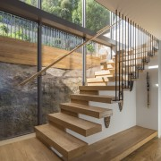 ​​​​​​​A timber-tread, cantilevered feature stair provides vertical access brown