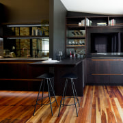 ​​​​​​​Dark veneer finish matched with copper accents on black, brown