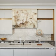 ​​​​​​​A simple symmetrical composition of cabinetry and appliances gray