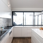 ​​​​​​​For this large family kitchen relocation and makeover gray