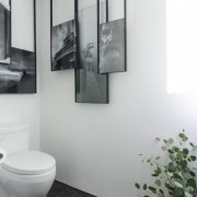 ​​​​​​​A feature of this powder room is the gray