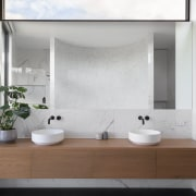 Floating the vanity in this contemporary master bathroom white, gray