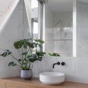 Marble-look walls and a wood veneer vanity together gray