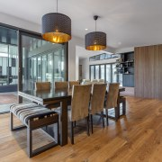 ​​​​​​​The expanded dining area in this home renovation gray