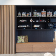 ​​​​​​​A comprehensive joinery element with storage and display black, white