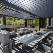 With a substantial outdoor fireplace, infrared heaters, and black, gray