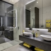 This refined master bathroom, directly behind the master
