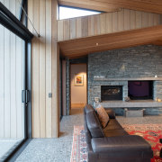Responding to the articulated roofline, the cedar ceilings