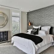 The master bedroom is in quiet, natural tones