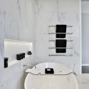 A freestanding tub not only looks elegant, it