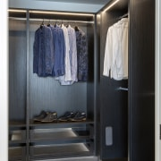 Finely crafted built-in cabinetry in this walk-in wardrobe