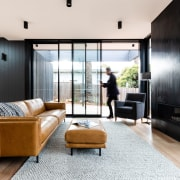 ​​​​​​​On this substantial renovation and expansion, floor-to-ceiling sliders white, black
