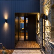 ​​​​​​​Exterior lighting accentuates the rough alongside the smooth black