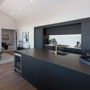 This living, dining, and kitchen zone opens to
