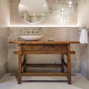 With a treated top surface, this vanity began