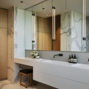 A room-length vanity is matched with mirror-front wall