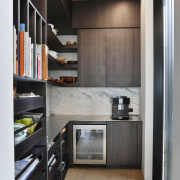 Surfaces in this rear butler's pantry echo those